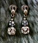 "SWAROVSKI SNAKE - Crystal/black and crystal/gold. 1.25"" Pierced. Hand set Swarovski crystals. $78"